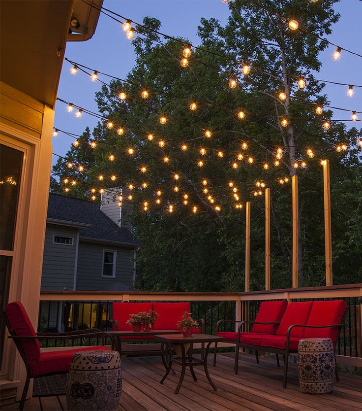 Best decor hacks hang patio lights across a backyard for Outdoor decorating hacks