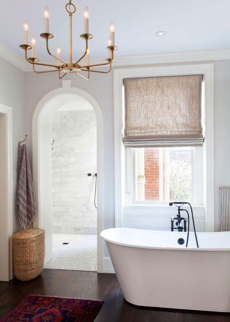 Bathroom Decor Ideas : A gold light fixture and a linen Roman shade ...